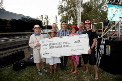 Photo of the Bigstock and OAS team with a donation check.